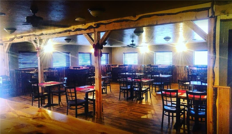 dining room at the bull pub setup with tables and chairs.