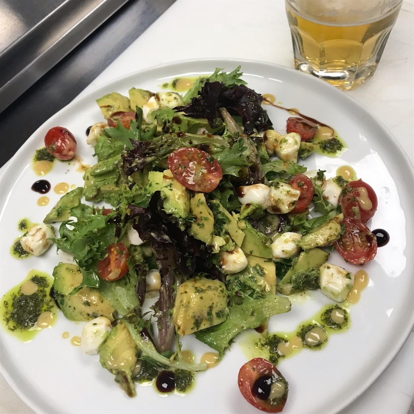special salad with avocado, tomato, cheese and dressing