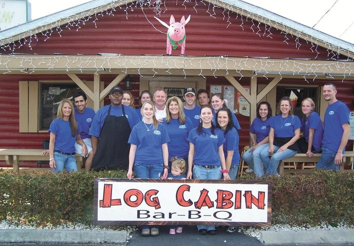 log cabin employees posing for a picture