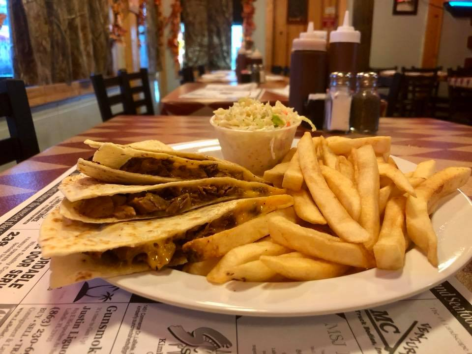chicken quesadilla with a side of fries and coleslaw
