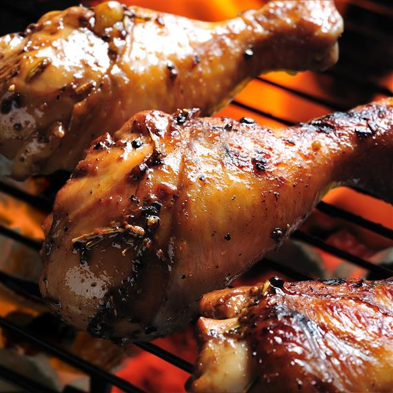 bbq grilled chicken legs on the grill