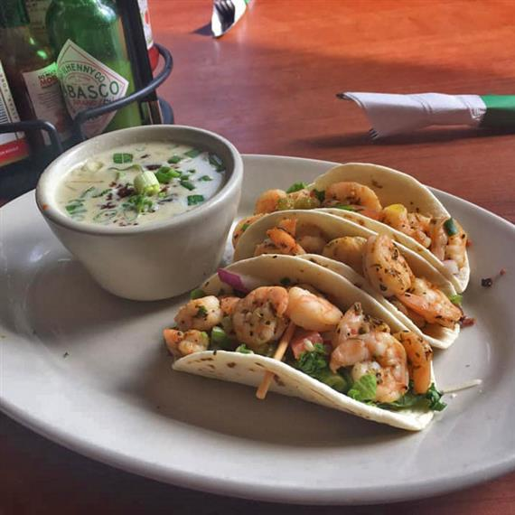 3 shrimp tacos with a side of soup