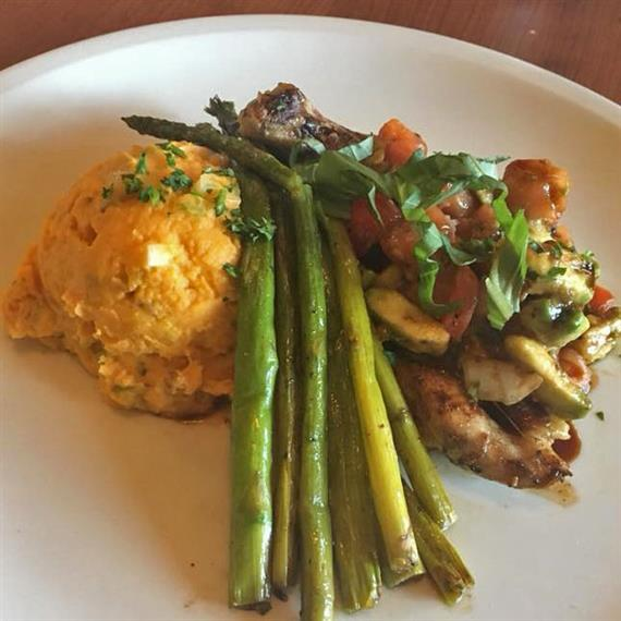 Cooked asparagus with mashed potatoes and roasted vegetables