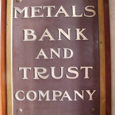 "A metal sign that says ""Metals Bank and Trust Company"" from the original building"