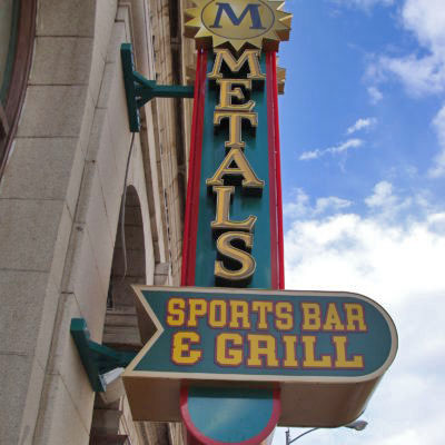 "The front sign that reads ""Metals Sports Bar & Grill"""