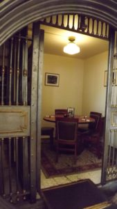 A private table set inside of a vintage bank vault