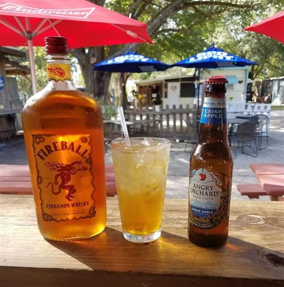 bottle of fireball and angry orchard and a cocktail in between them