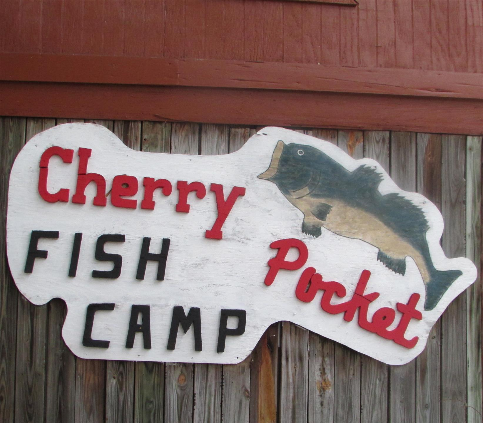 sign that reads cherry pocket fish camp