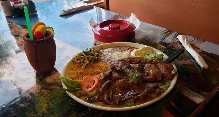 Steak Ranchero: Top sirloin grilled & sliced with green peppers, onions & spices. Served with rice, beans, tomatoes, guacamole & tortillas