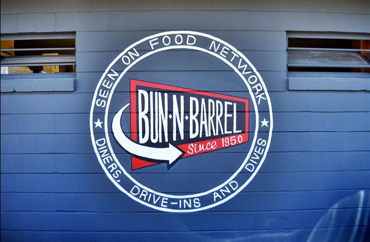 """Seen on Food Network: Diners, Drive-Ins and Dives: Bun-n-Barrel, since 1950"" painted the outside of the building"