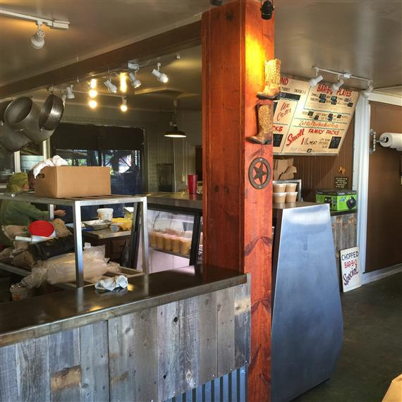 An inside view of the front counter at the BBQ Pit