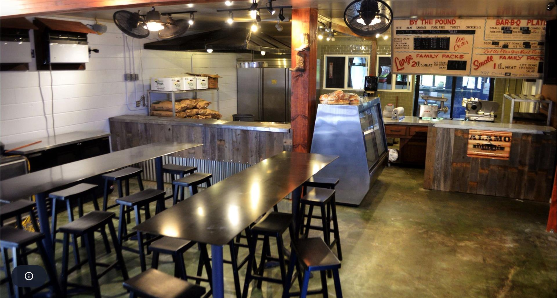 The dining area of the inside BBQ Pit, which includes, high top tables and stools
