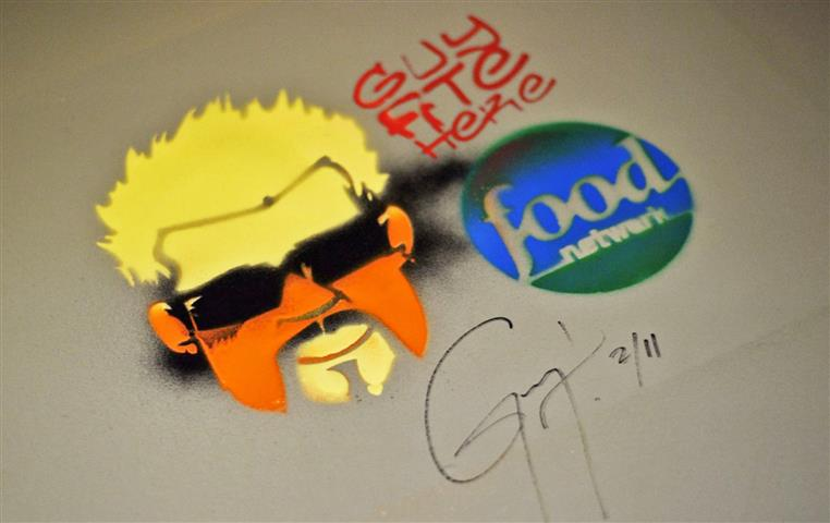 Guy Fieri's signature on spray paint stamp from his visit while filming the Food Network Show, Diners, Drive-Ins and Dives""