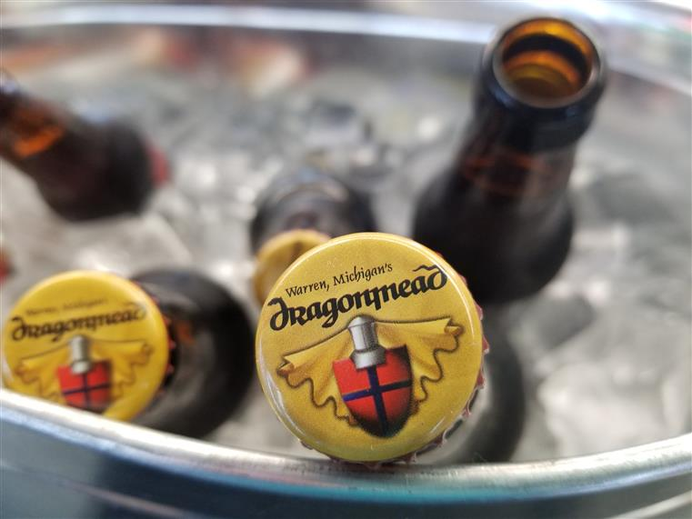 bottles of dragonmead beer in a big bucket with ice