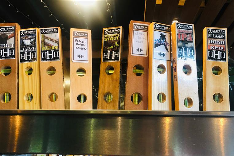 bar tap handles for Huske Brewing Company shaped like levels.