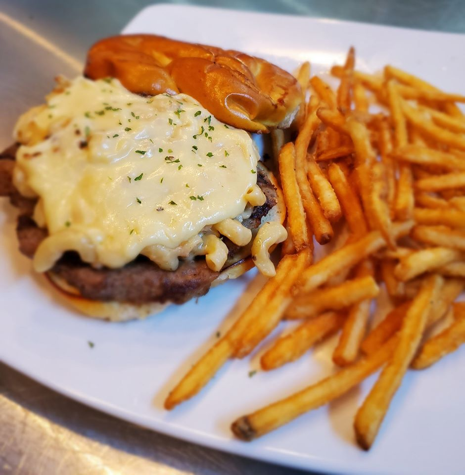 Mac n Cheese burger with a side of French fries