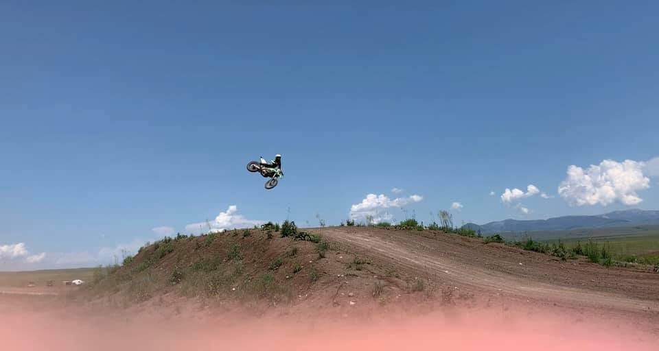 someone doing a jump on the dirtbike track