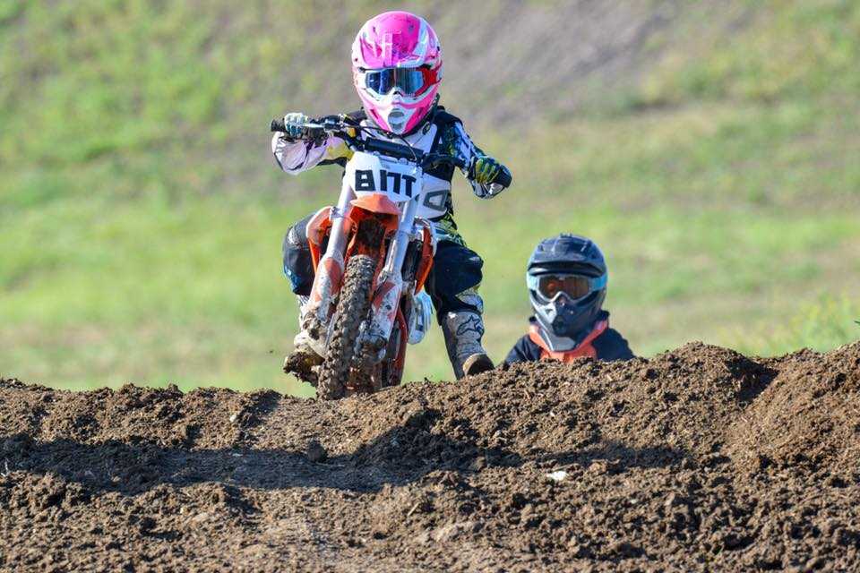 people riding dirt bikes on the track