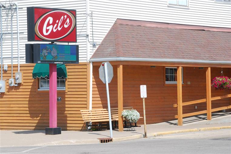 Exterior of Gil's Supper Club next to bench