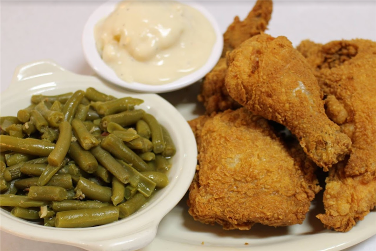 Fried chicken with a side of green beans and mashed potatoes