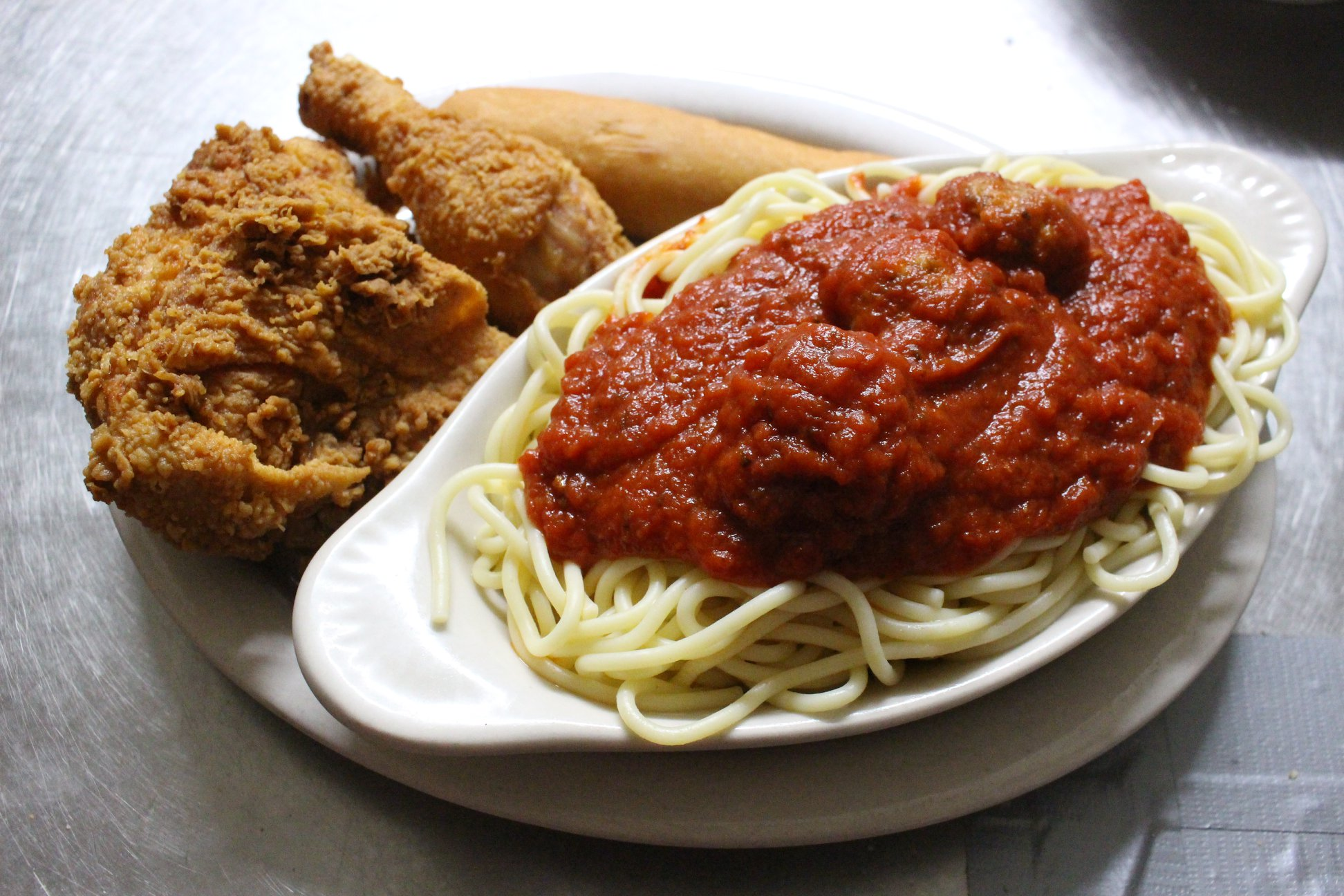 Fried chicken and a bowl of spaghetti with meat sauce