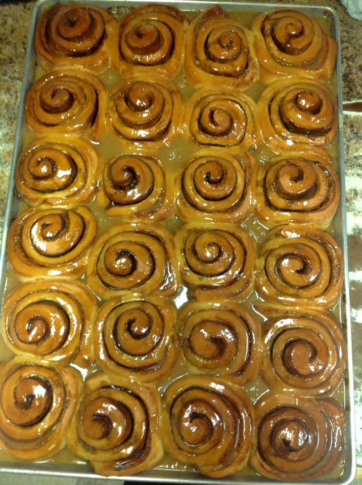 assortment of cinnamon rolls on a tray