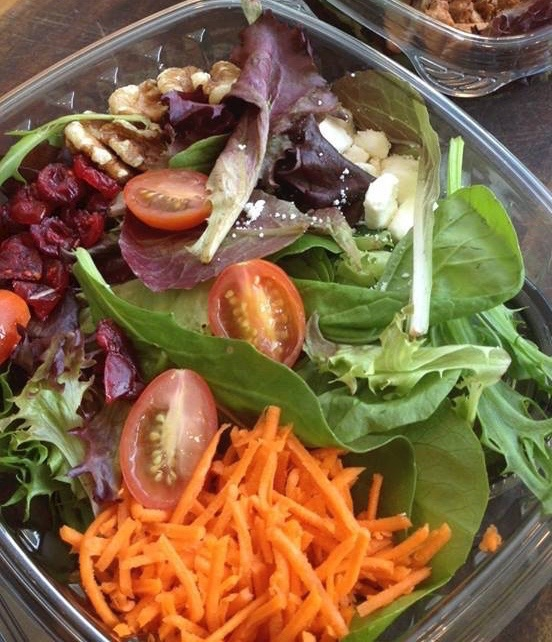 Mesclun Greens salad with cherry tomatoes, mushrooms, walnuts, cranberries, and carrots