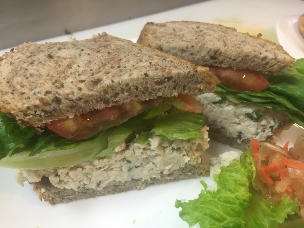 Chicken salad sandwich with lettuce and tomato