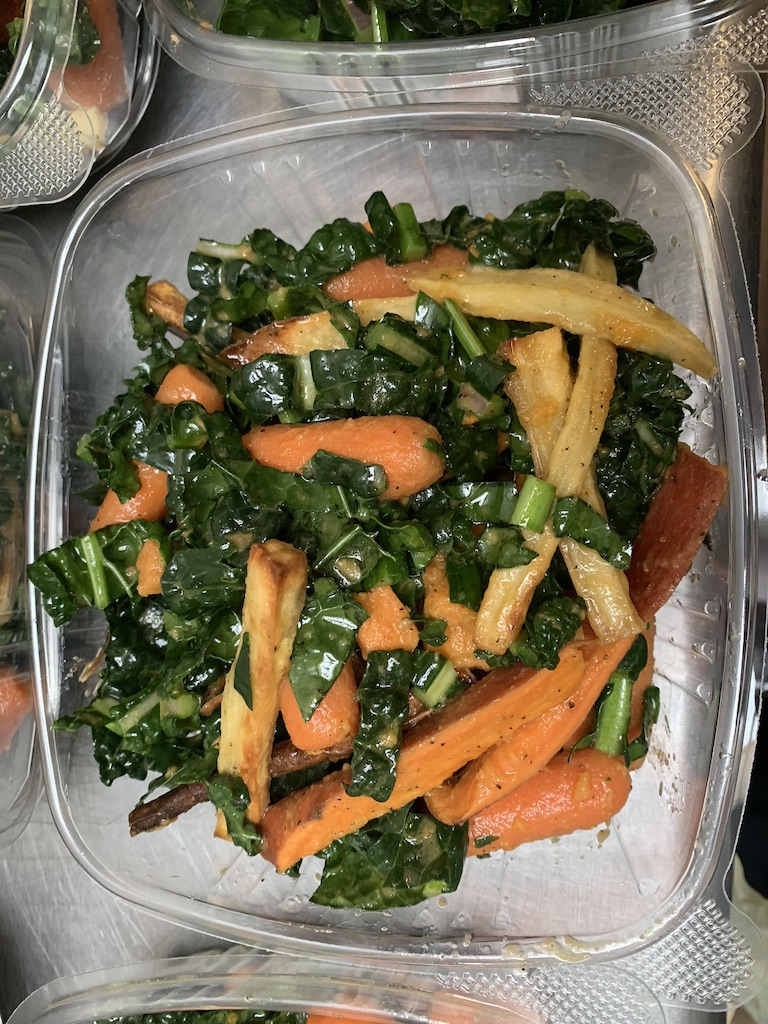 Carrot and kale slaw in a to-go container