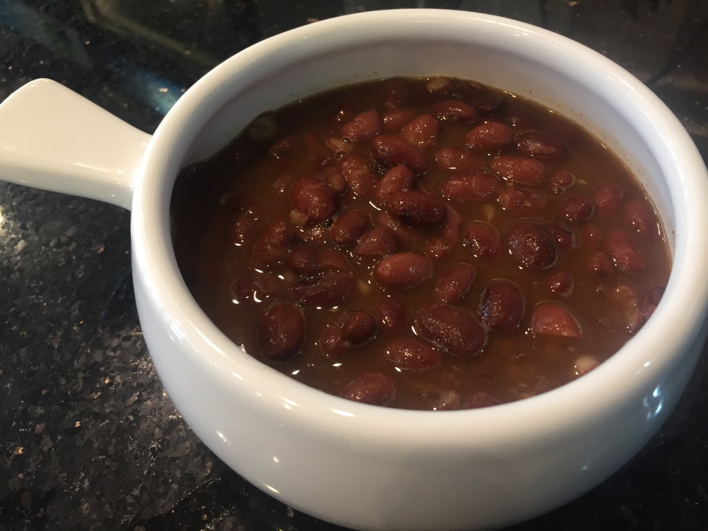 A bowl of baked vegetarian beans