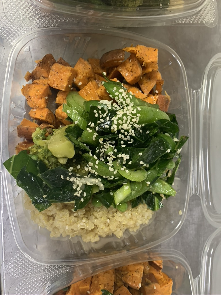 A sweet potato and quinoa salad topped with sesame seeds
