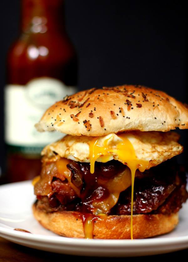 Sunrise Burger: Bacon cheeseburger topped with nacho cheese and a fried egg.