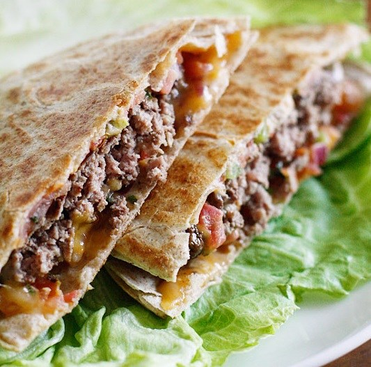 Quesadilla burger with cheese and pico de gallo in a tortilla
