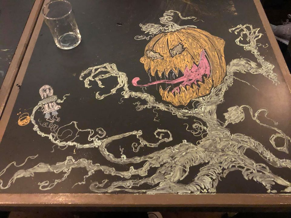 chalk art of a pumpkin and a ghost