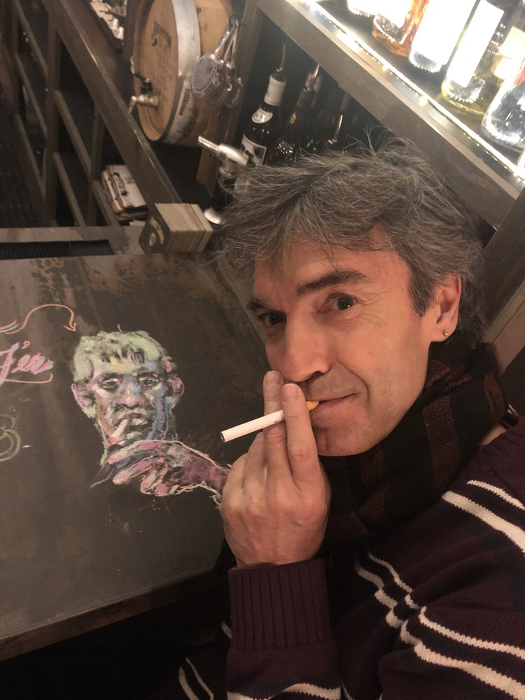 chalk art with man posing at table