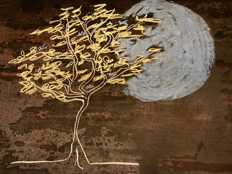 chalk drawing of a tree and a moon
