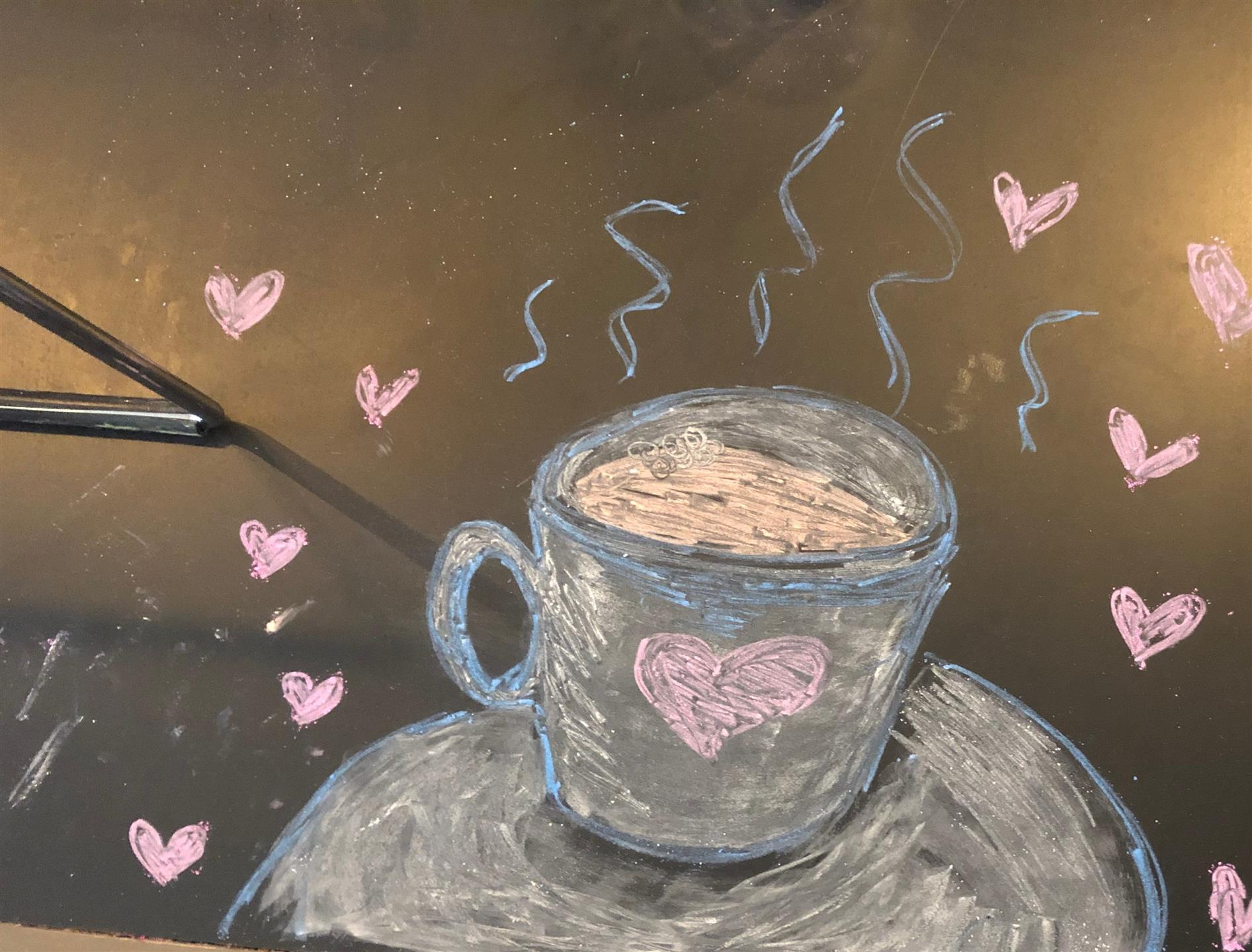 chalk drawing of a cup of coffee and hearts