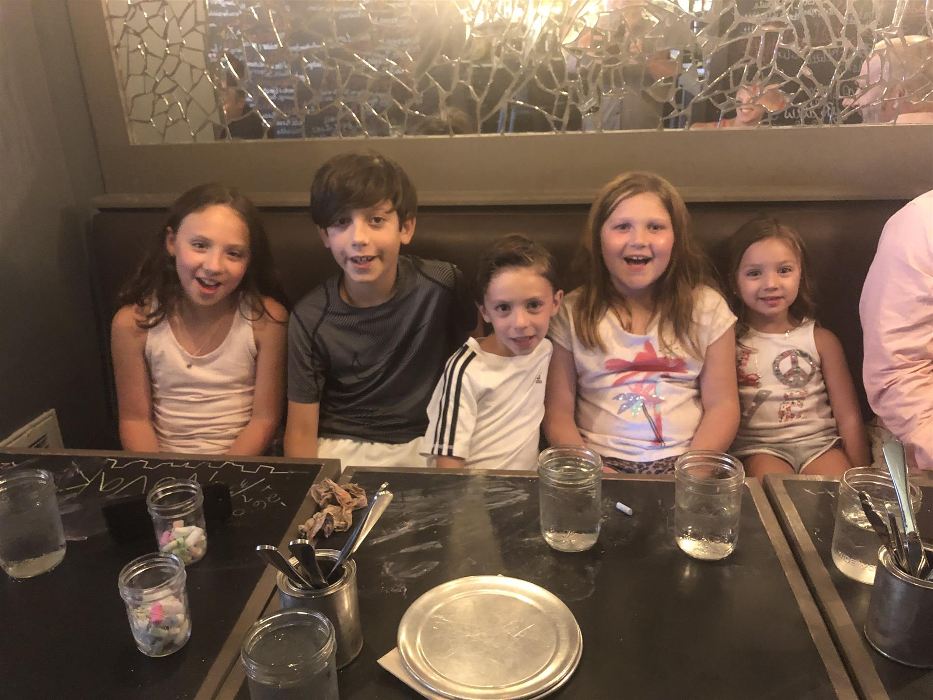 group of kids sitting at a table