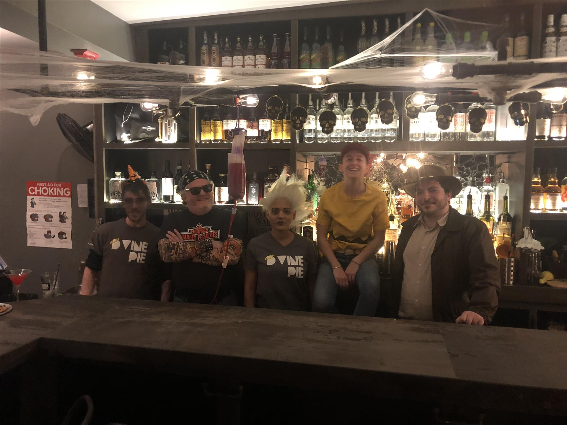 group of people standing behind the bar area