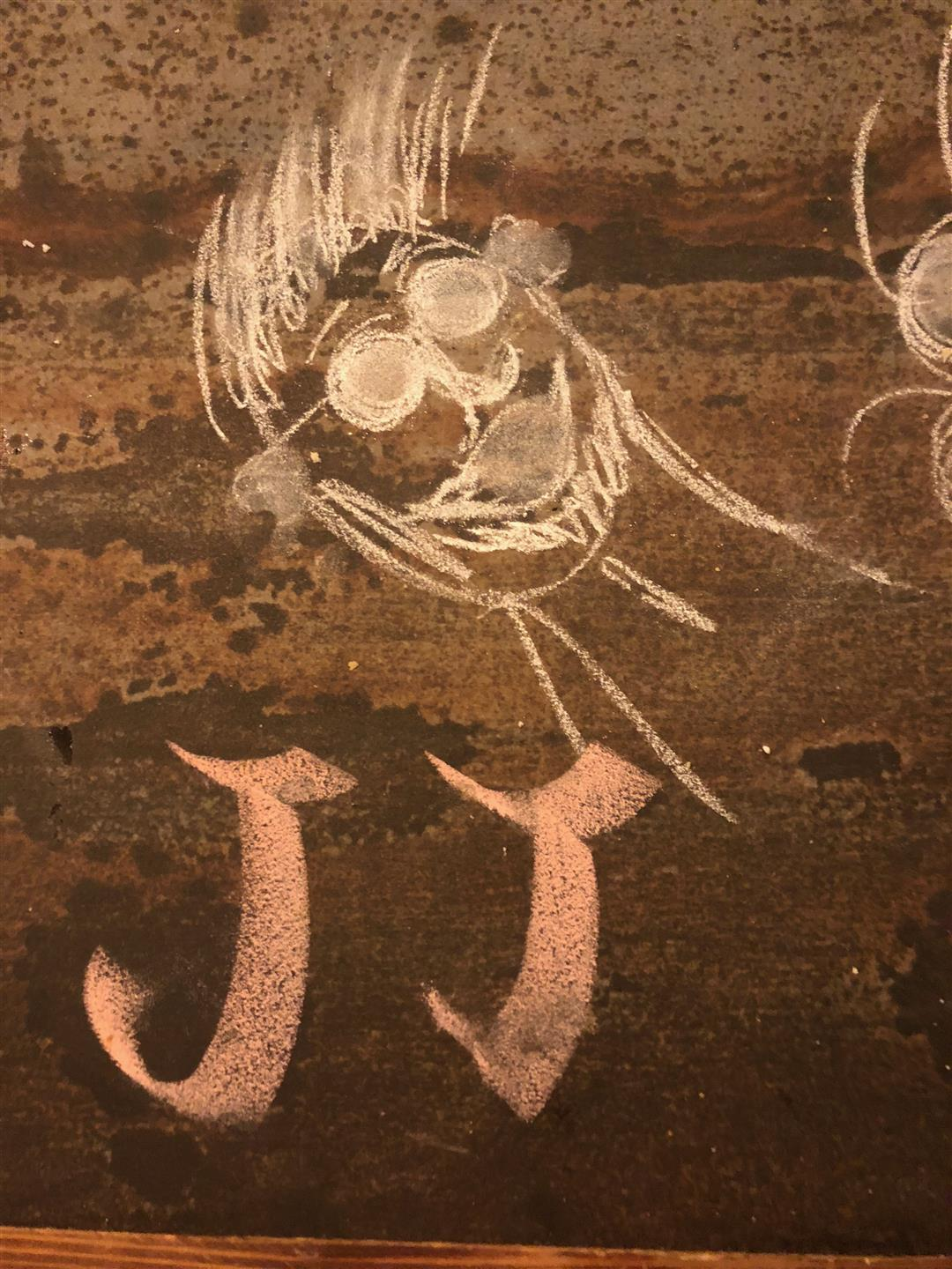 chalk drawing of a man with initials
