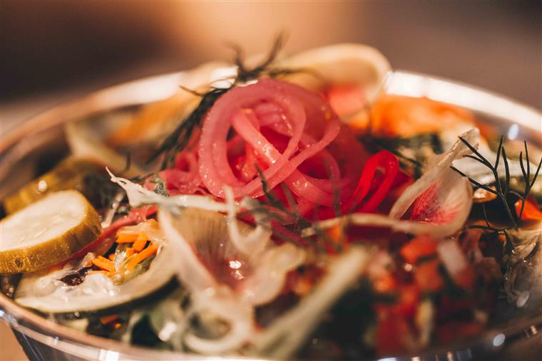 salad with fresh dill, pickled red onions, cucumbers, pickles, and other various toppings