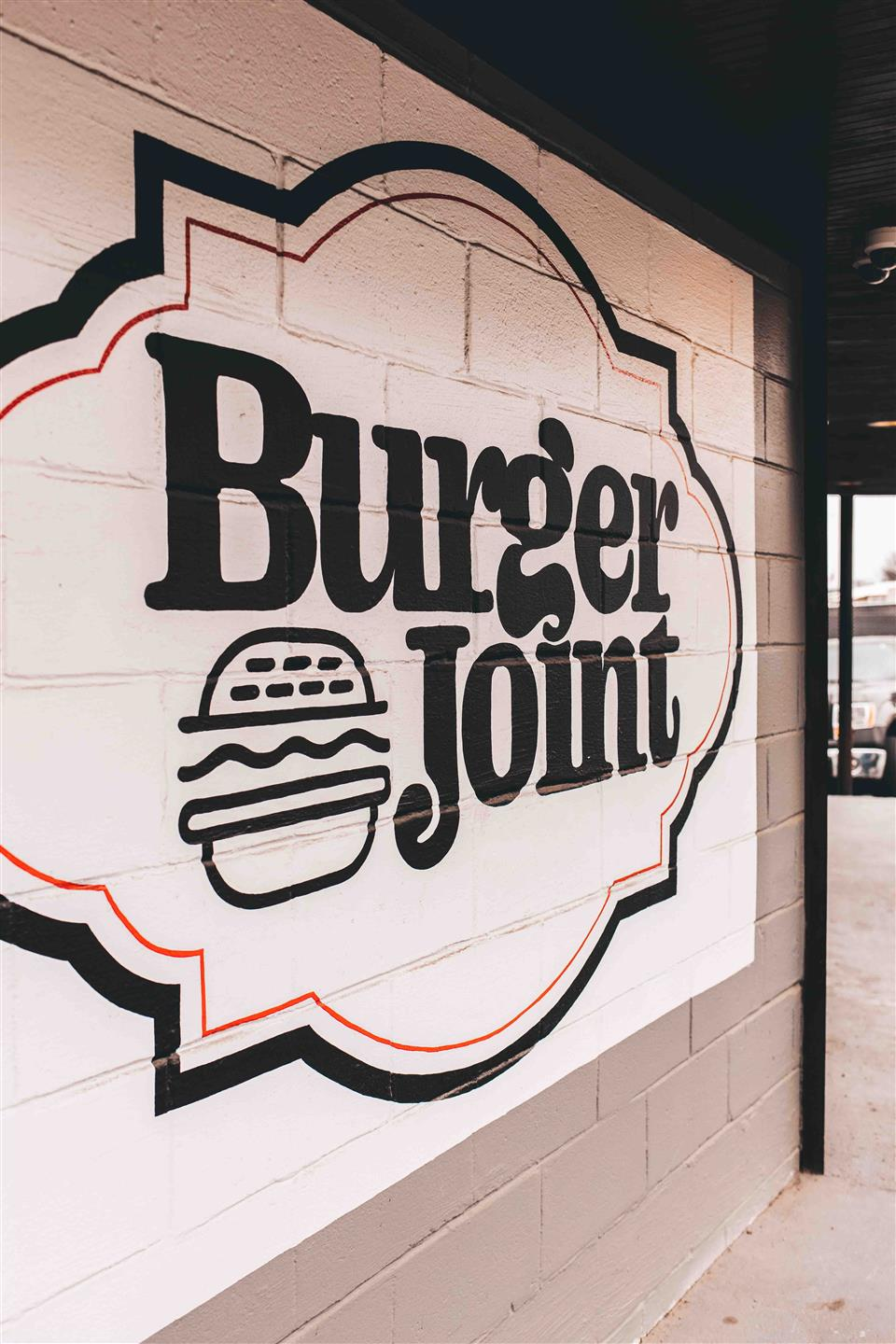 Burger Joint sign on wall inside restaurant
