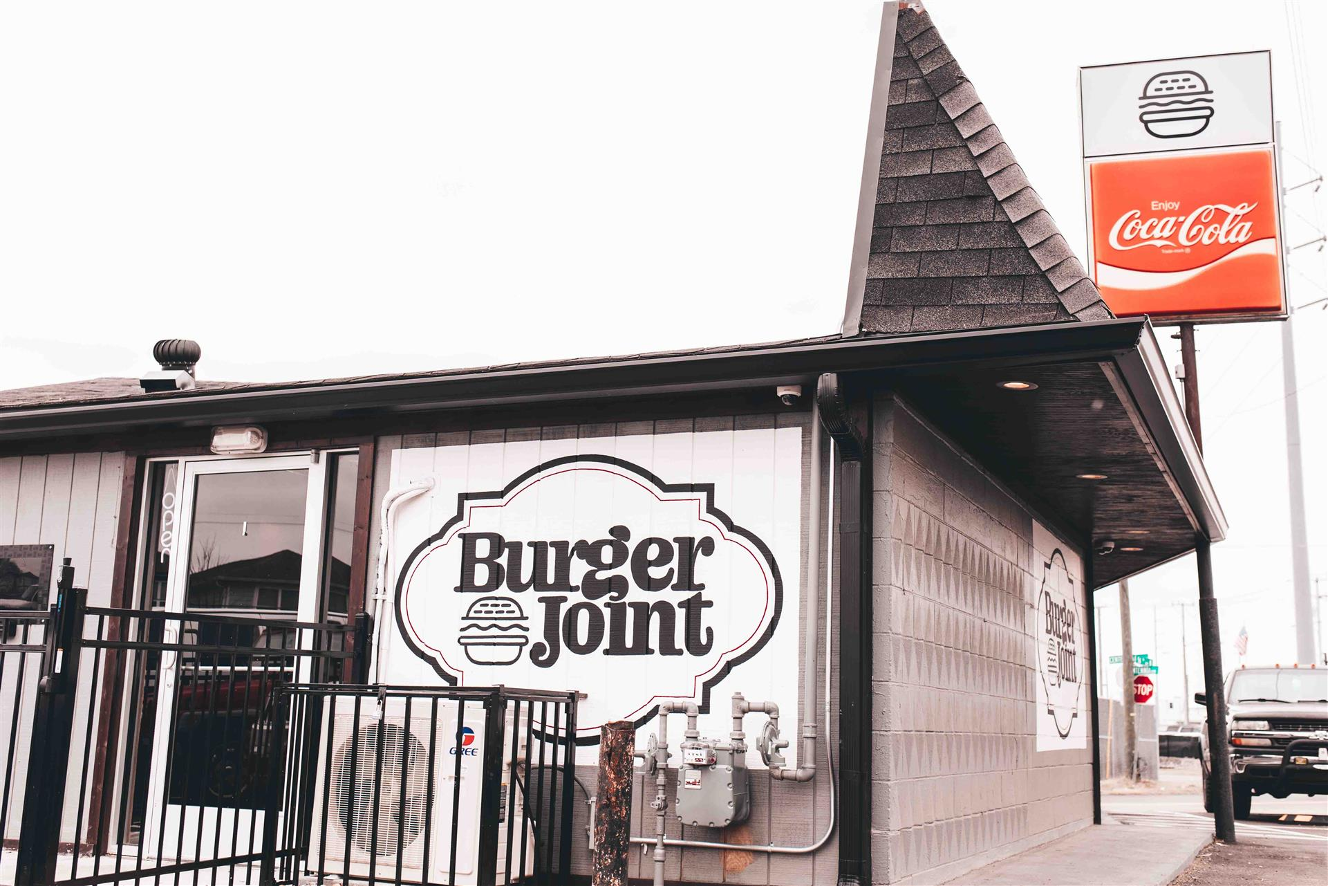 exterior of the restaurant with view of Burger Joint sign