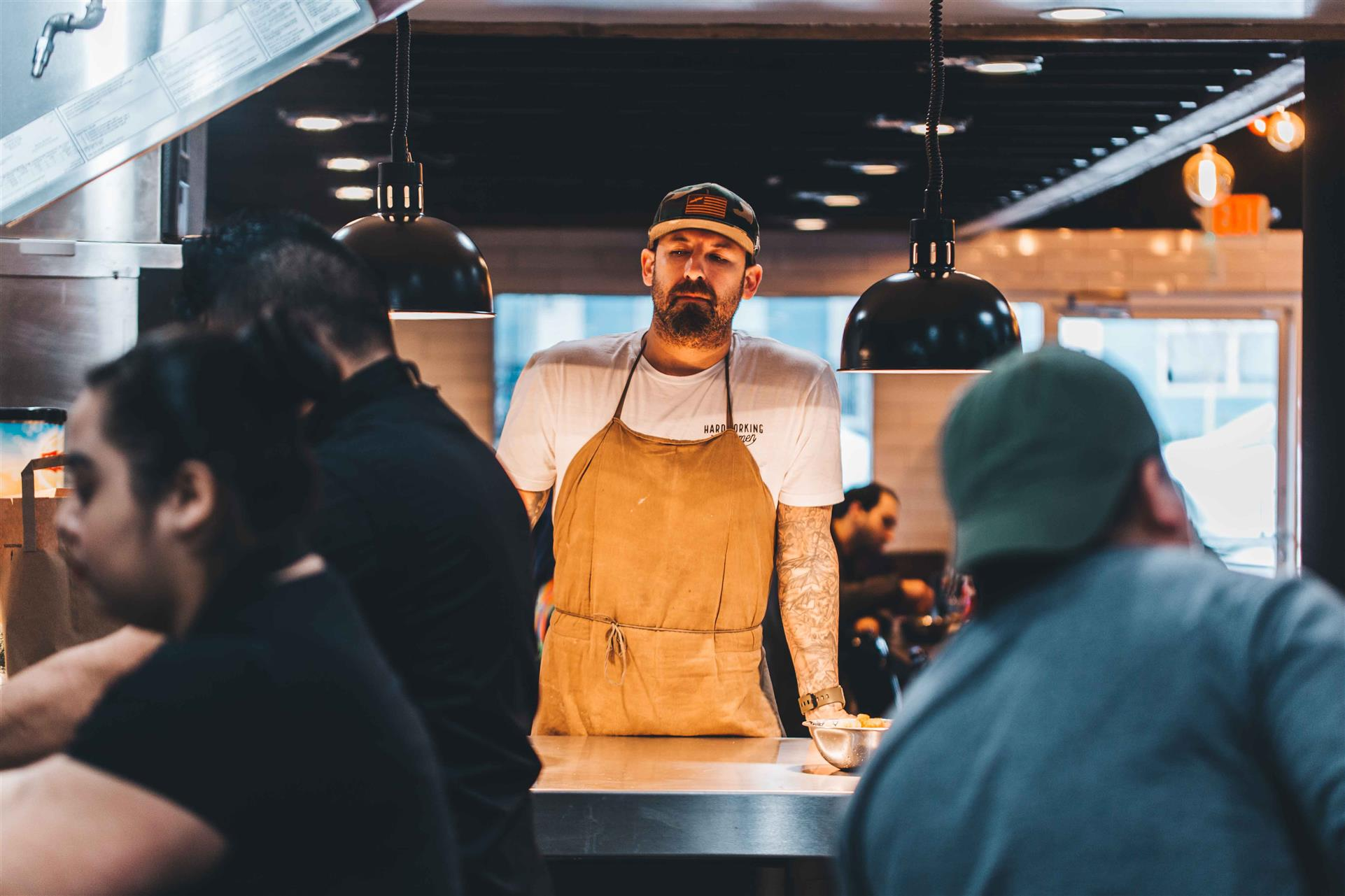 chef at the line waiting for orders to be placed