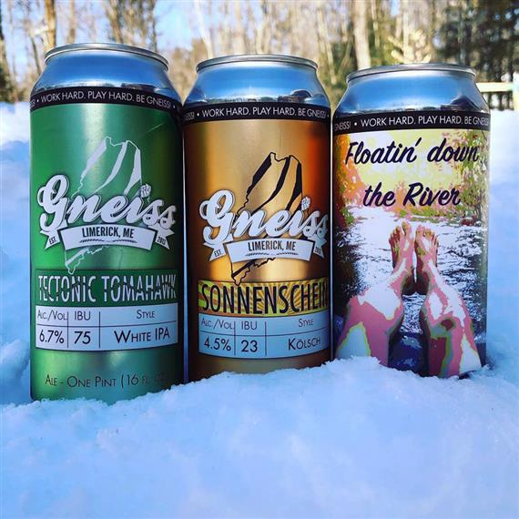 3 cans of Gneiss Beer resting in the snow