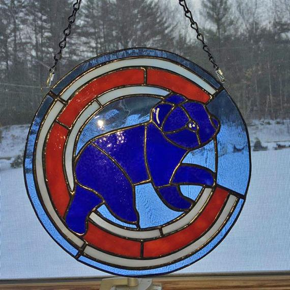 A stained-glass design of the Chicago Cubs Football team logo
