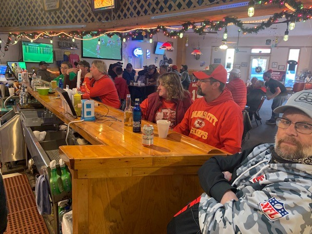 people sitting at the bar inside the restaurant