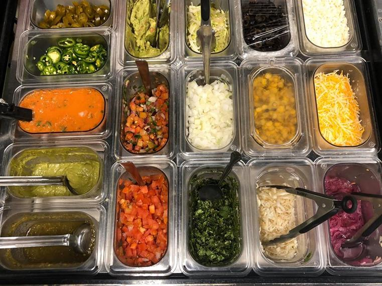 topping options such as sauce, jalapenos, cheese, pico de gallo, onions