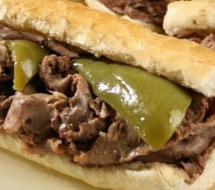 philly cheese steak with green peppers on a toasted sub