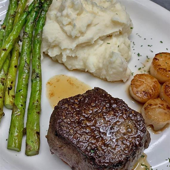 Filet mignon with a side of asparagus and mashed potatoes
